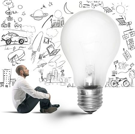 A man thinking in front of a lightbulb.