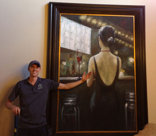 Dan Perry next to large painting
